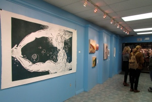 "My work is the large blue-green woodcut, titled ""Follow"". 4' x 6'"