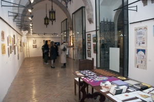 the beautiful Le Logge Gallery located in the central Piazza del Comune of Assisi